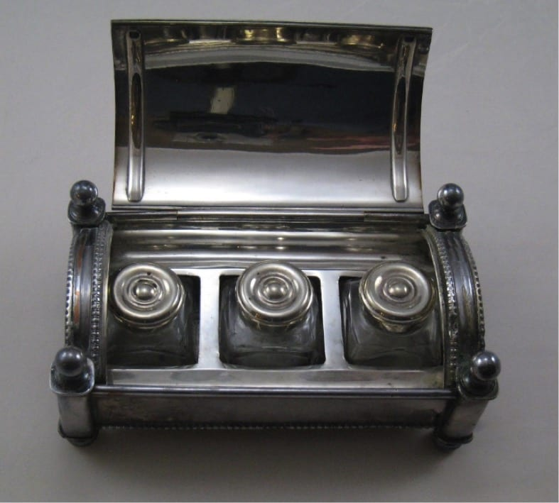 Robert Southey's inkstand. Robert Southey's inkstand is made of silver.  It is in the shape of a chest, inscribed on the top with 'Robert Southey, Greta Hall'. Inside are three inkpots.