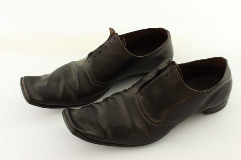 Robert Southey's dress shoes. Robert Southey's square-toed dress shoes are made of black leather, with six pairs of eyelets on each shoe, leather soles and nailed heels. They would have been worn on formal occasions.